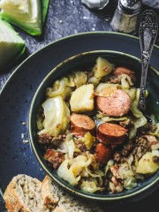Cabbage, bacon, ground beef, kielbasa, and potatoes make this delicious German stew - Jägerkohl