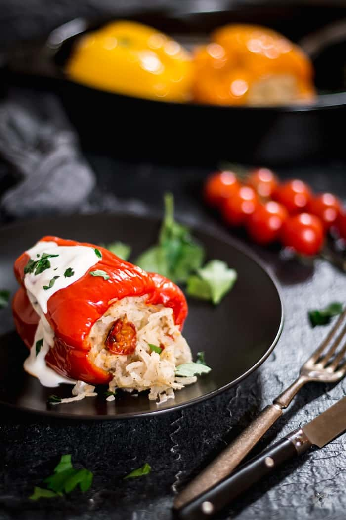 Delicious recipe of oven-roasted vegan stuffed sweet bell peppers.