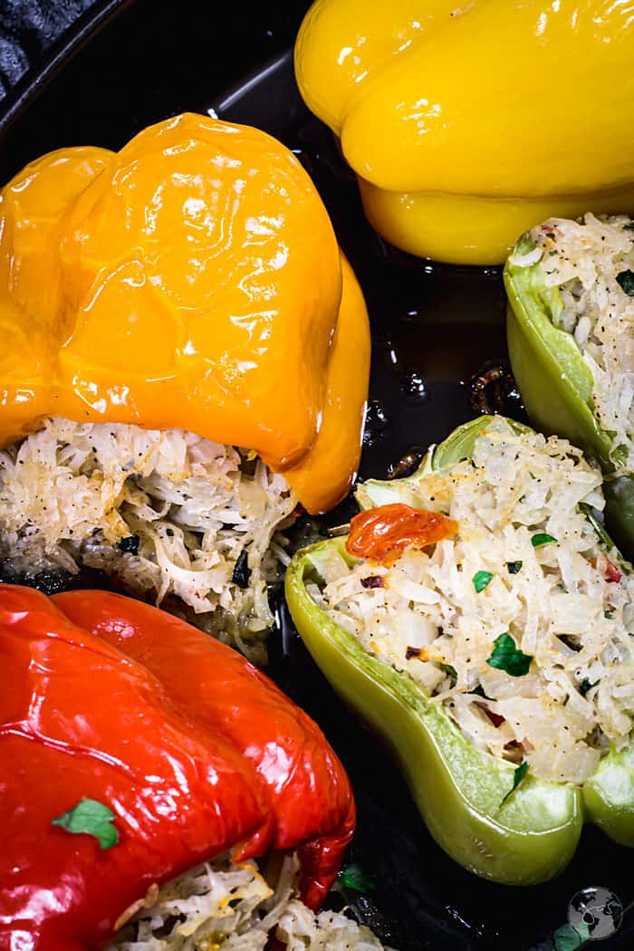 Close up of colorful bell peppers stuffed with potato mixture.
