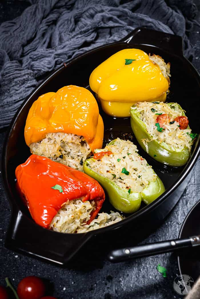 Vegan stuffed roasted peppers in the baking dish.