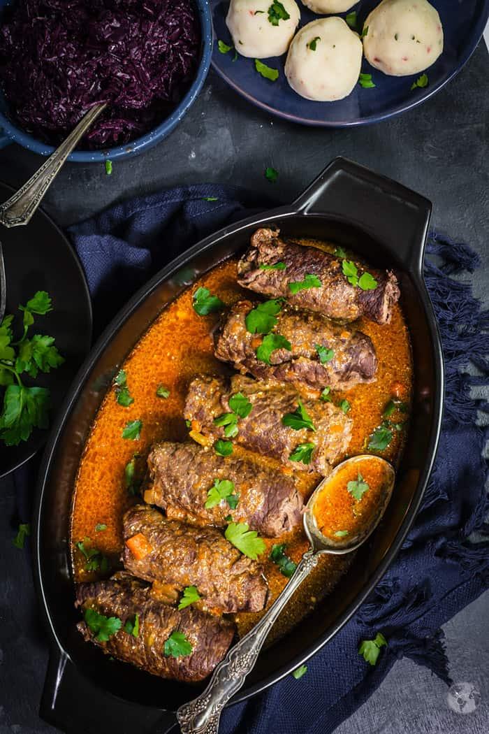 Stuffed beef roll-ups in the pan.