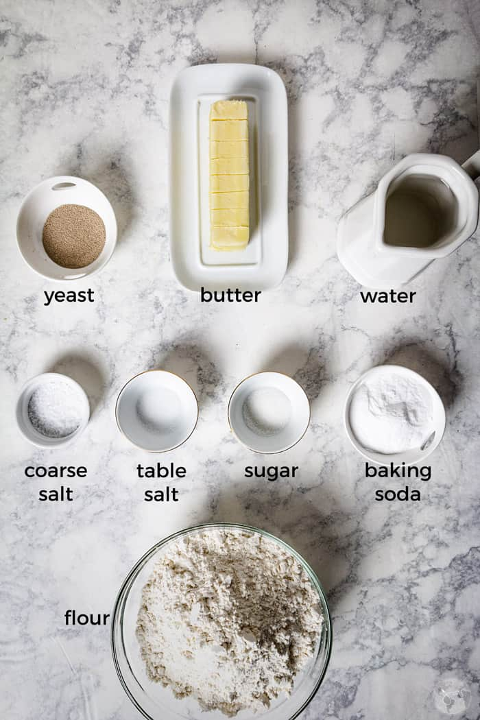 Simple ingredients for Bavarian pretzel pastries on a counter.
