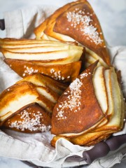 Pretzel wedges stacked in a basket.