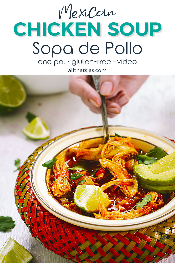 Mexican chicken soup in a colorful bowl, with a hand holding a spoon - with text overlay