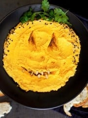 "Halloween pumpkin hummus ""face"""