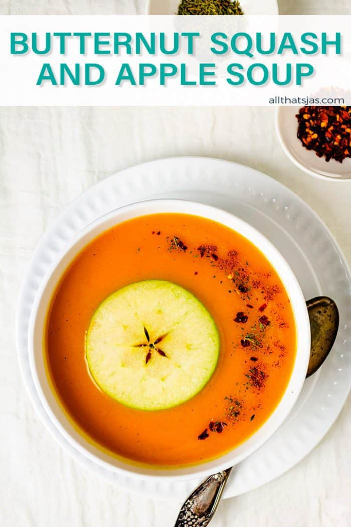 Butternut soup in a white bowl on a white plate with a wite background and text overlay