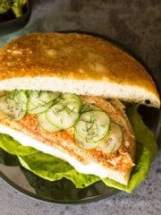 A sandwich with fish and cucumbers