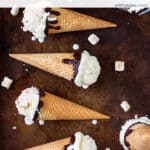 S'mores ice cream cones on a brown background with text overlay