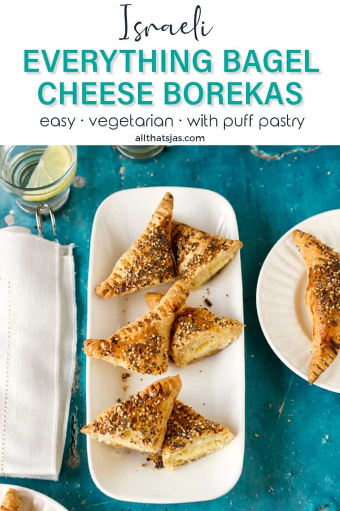 Overhead shot of triangle cheese pastries on a white dish and blue background with text overlay.