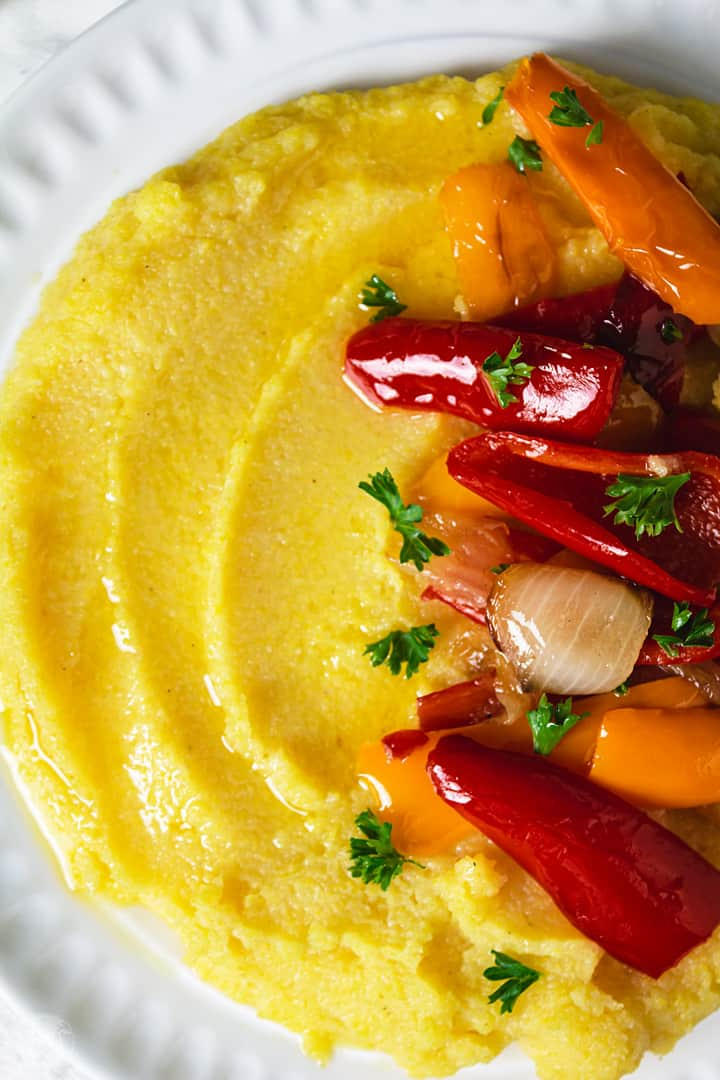 Close up shot of polenta and vegetables.
