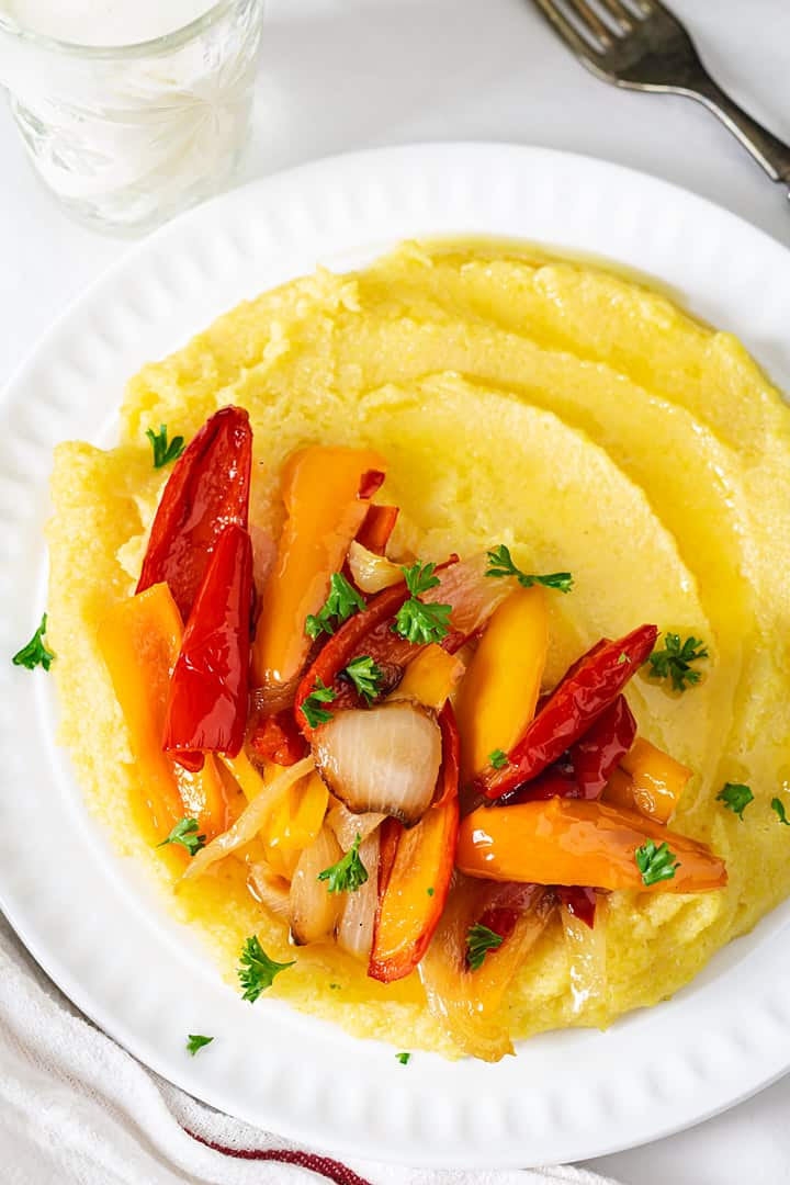 Bosnian style cooked cornmeal (pura) with red and orange peppers and onions.