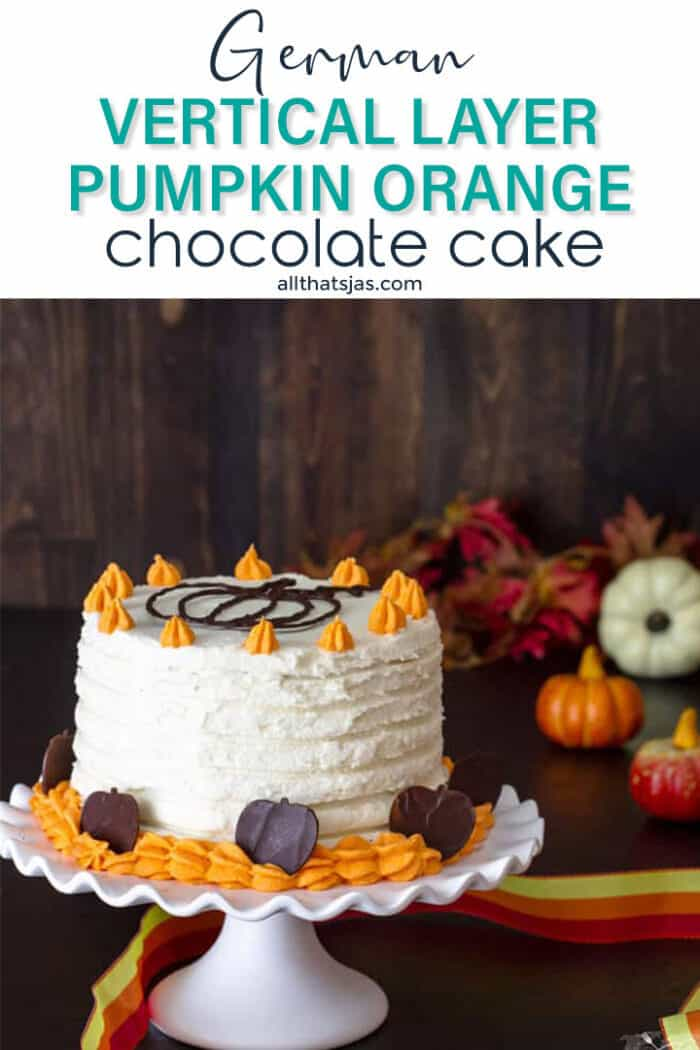 Pumpkin cake with white frosting on a dark wooden background with text overlay.