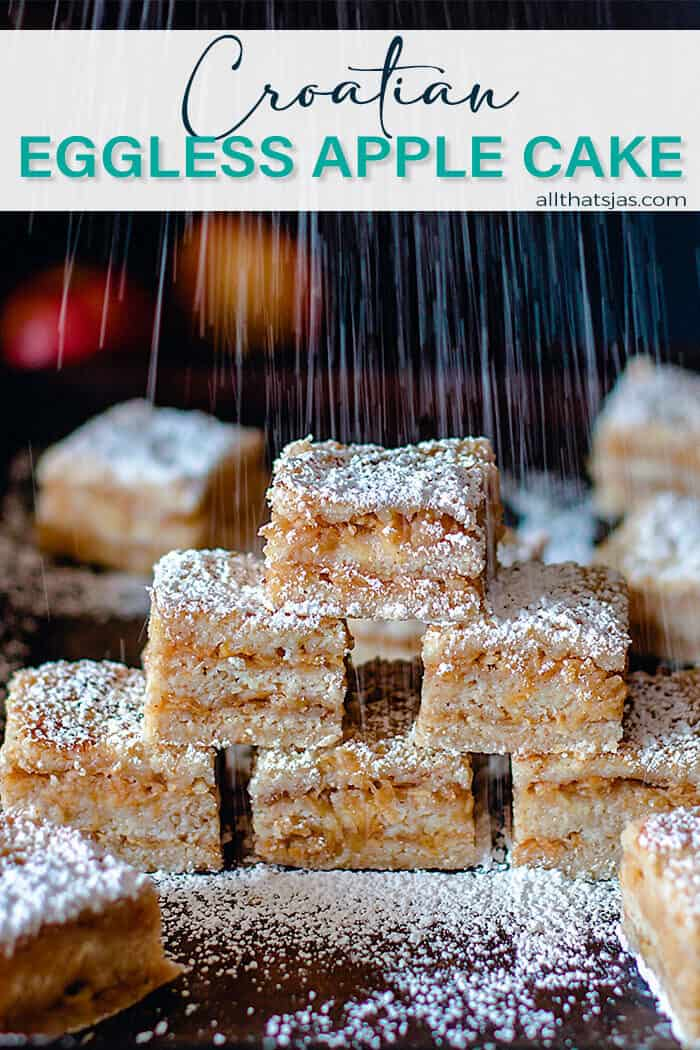 A pyramide of apple cake squares being dusted with powdered sugar and with text overlay