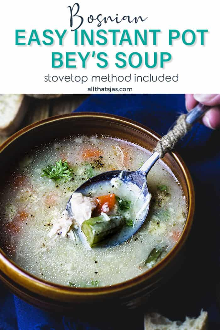 A bowl of Bey's soup being scopoped up with a spoon with text overlay