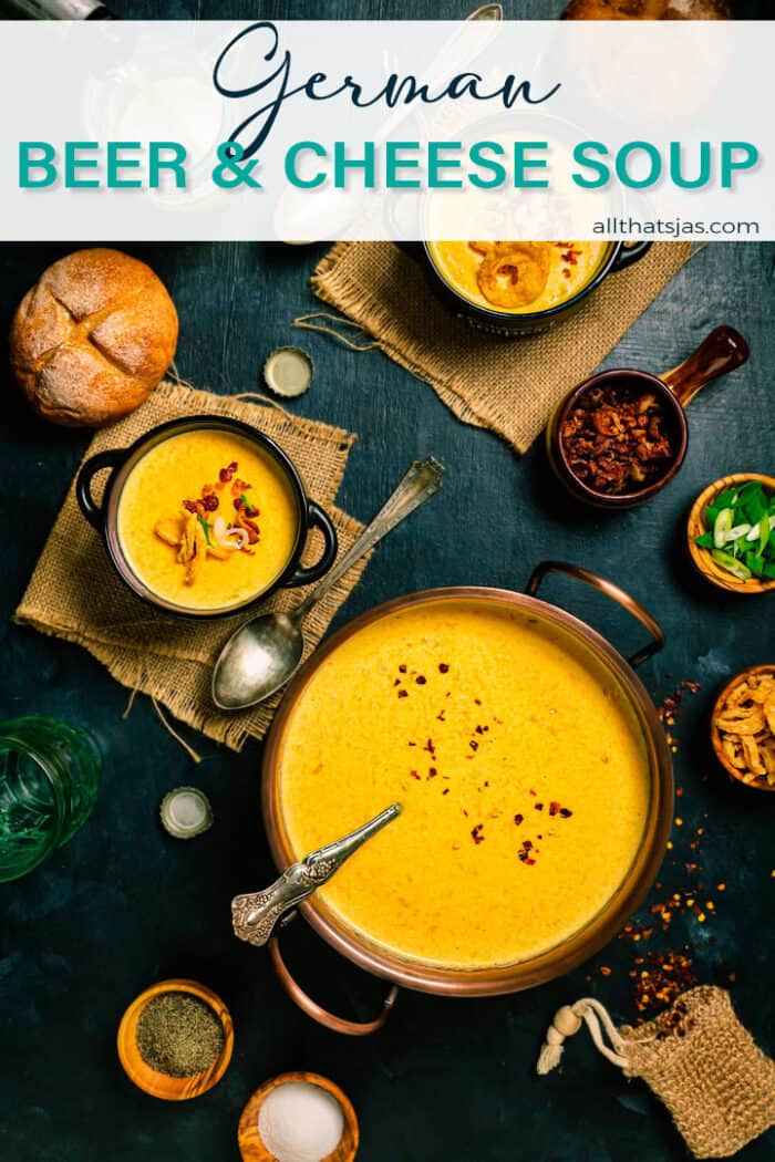 A flat lay shot of the cheese beer soup in a large copper bowl and two servings with text overlay