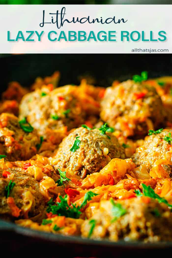 Close up shot of meatballs over cabbage with text overlay.