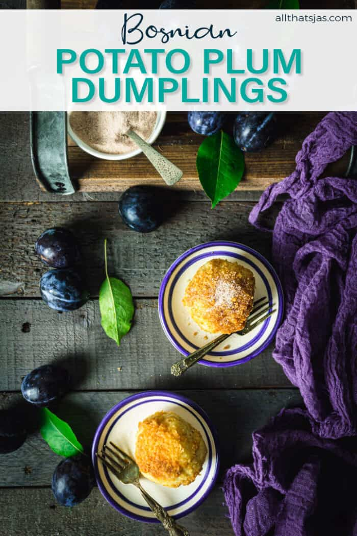 An flat lay of plum dumplings on small plates with fresh plums around it and text overlay.