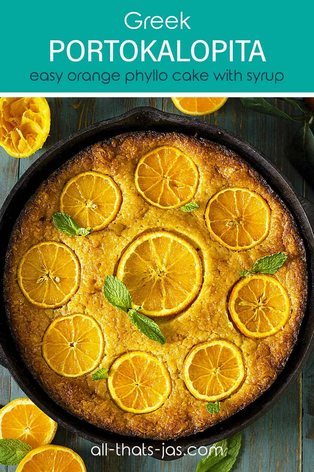 A cake in a cast-iron skillet with oranges and text overlay.