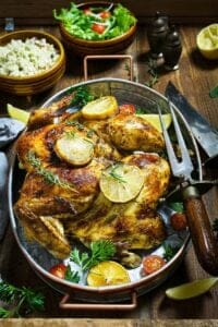Served whole butterflied bird with herbs and lemon.