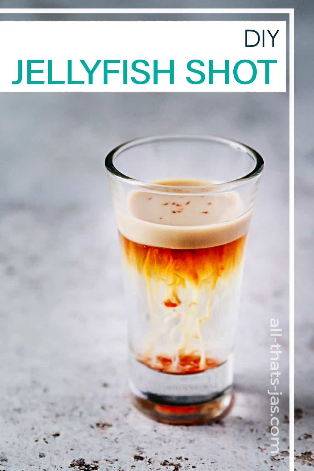A small shot glass with jellyfish drink and with text