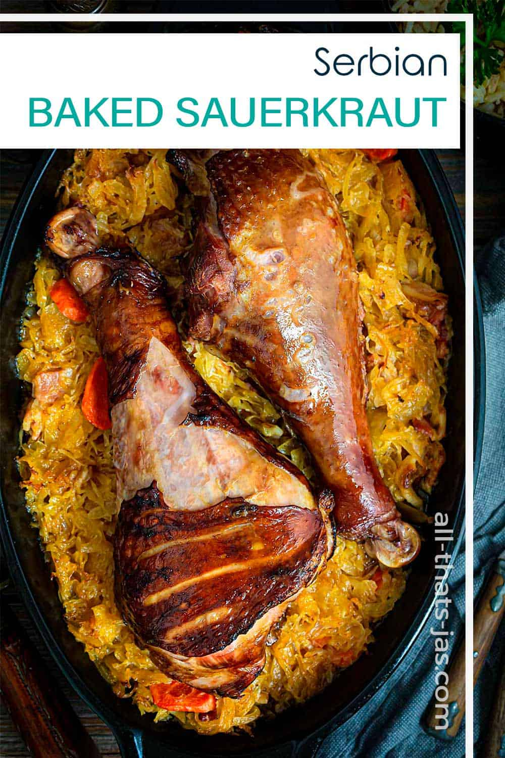 A close up of food in baking dish with turkey legs, cabbage, and with text