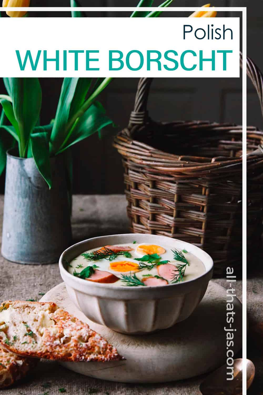 A serving of white borscht with eggs and sausage served with bread on a table wit Easter setting and a text overlay.
