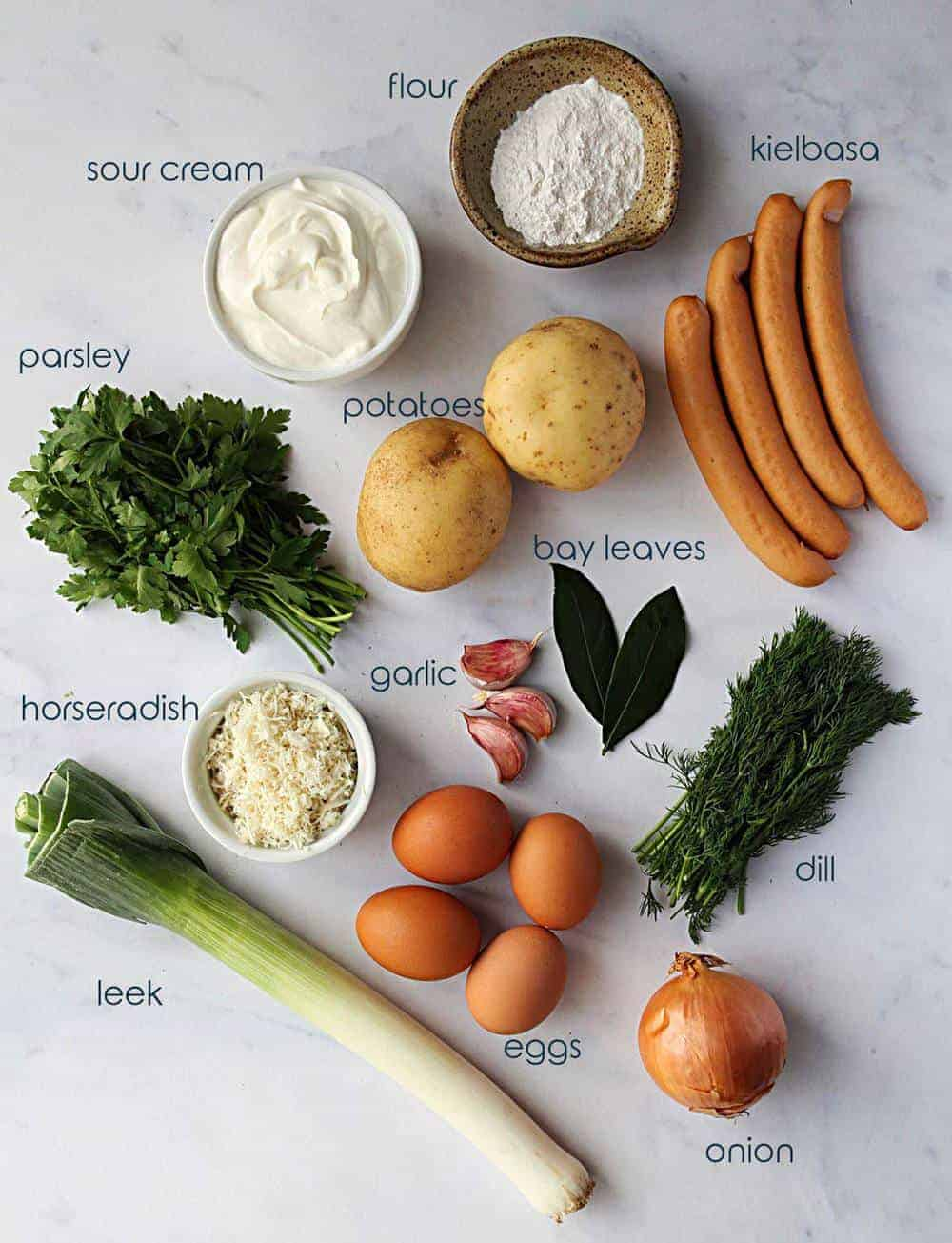 Smoked sausage, leek, eggs, potatoes, and other ingredients for white borscht recipe.
