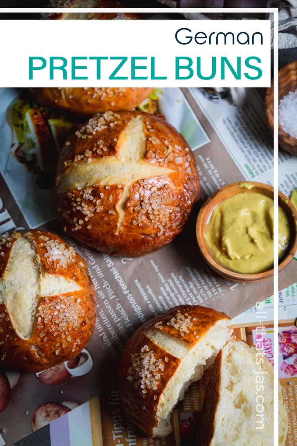 Pretzel rolls on spread on German magazine with mustard and text overlay.