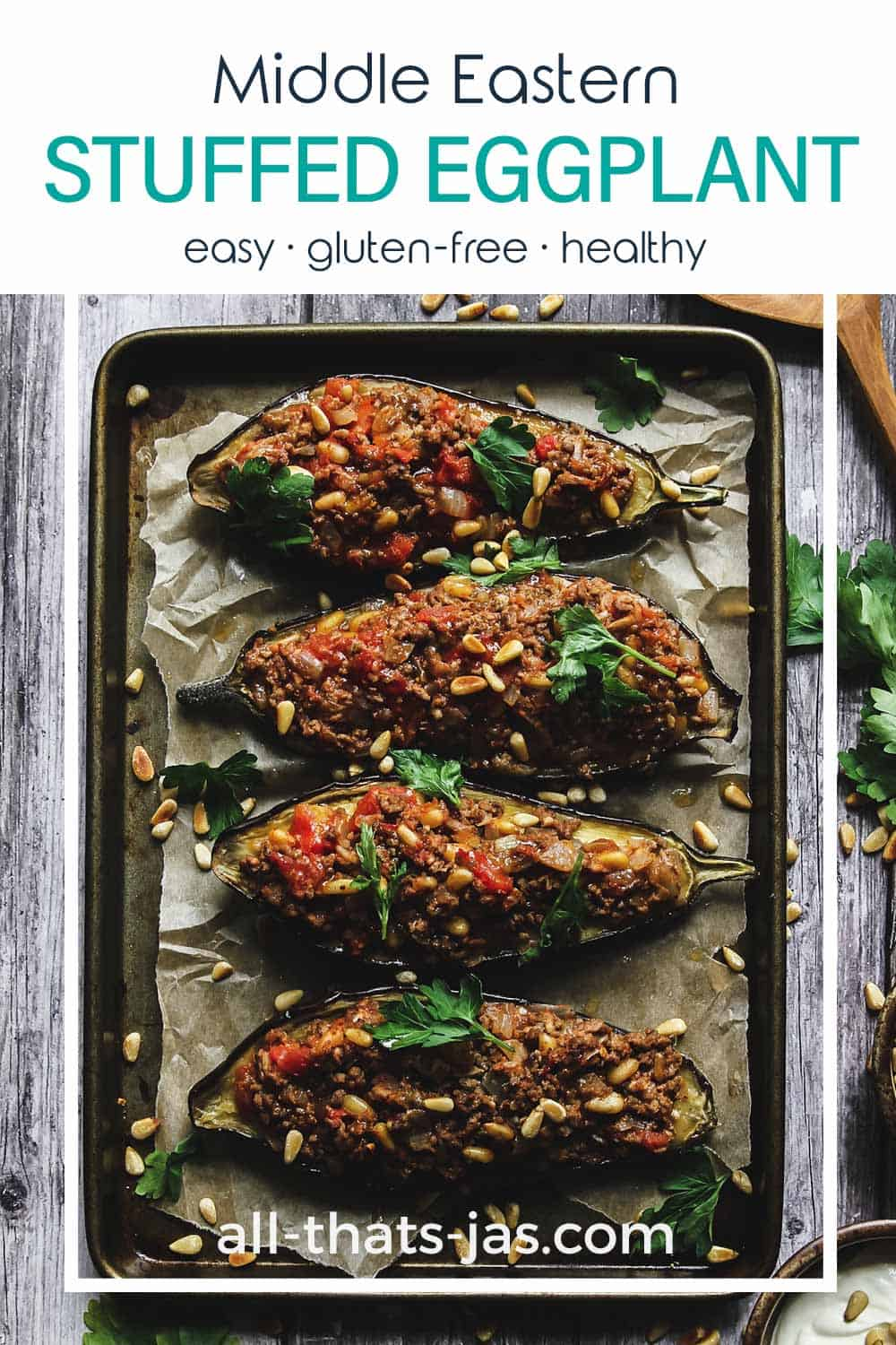 An overhead view of stuffed eggplants on a baking sheet with text overlay.