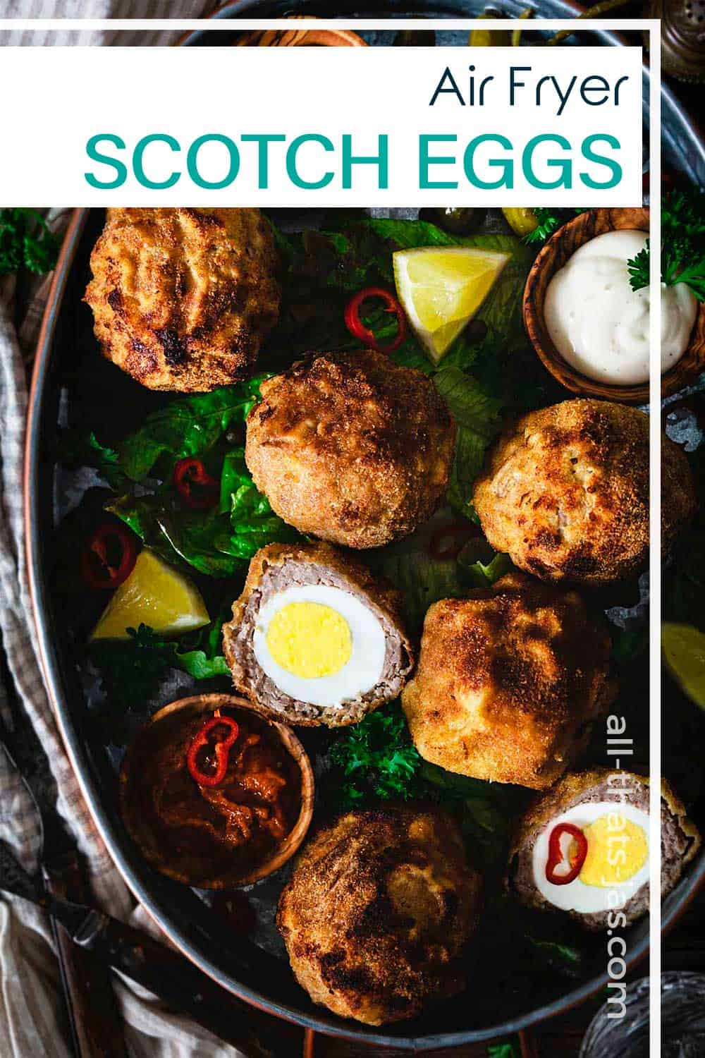 Whole and halved Scotch eggs with text overlay.
