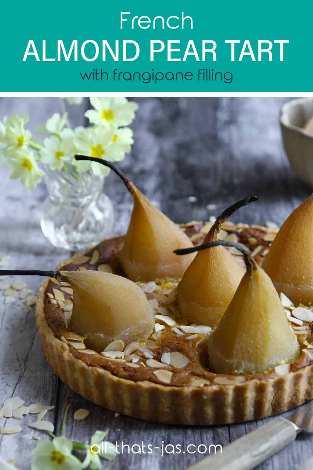 A tart with whole poached pears and text overlay.