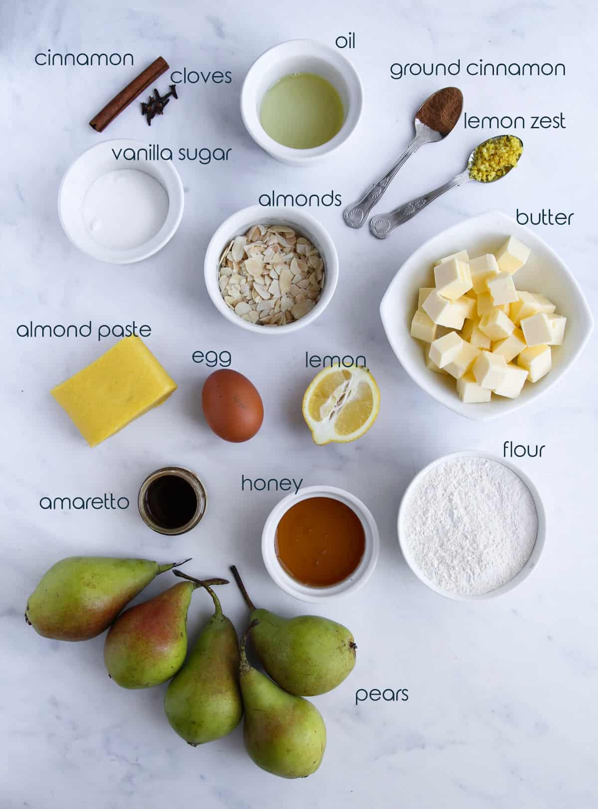 Ingredients for almond pear French tart placed on the counter.