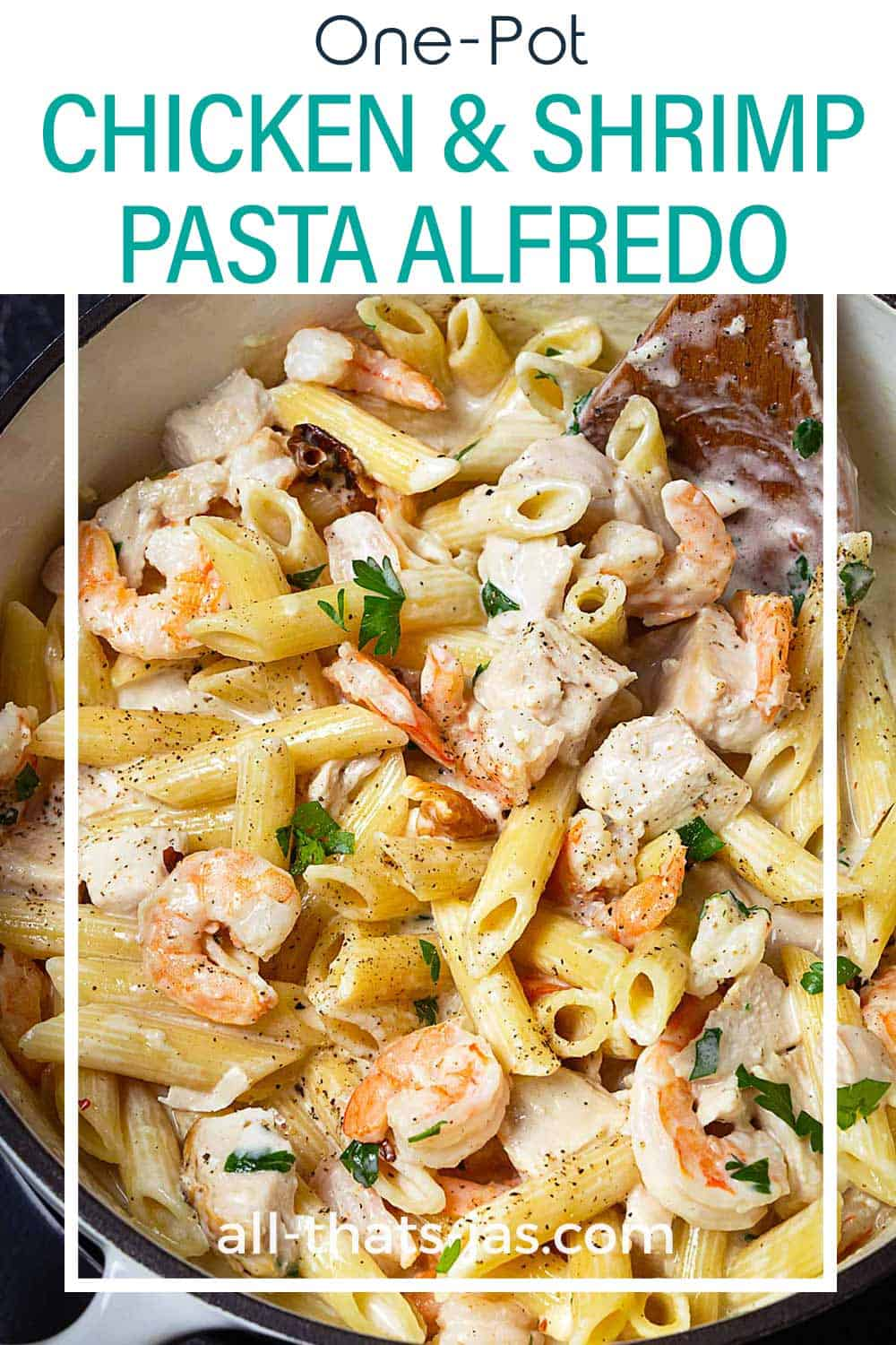 A close up of coked chicken shrimp pasta alfredo in one pan with text overlay.
