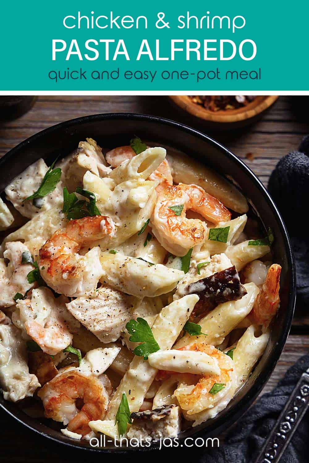 A close up pasta with chicken and shrimp scampi in a bowl with text overlay.