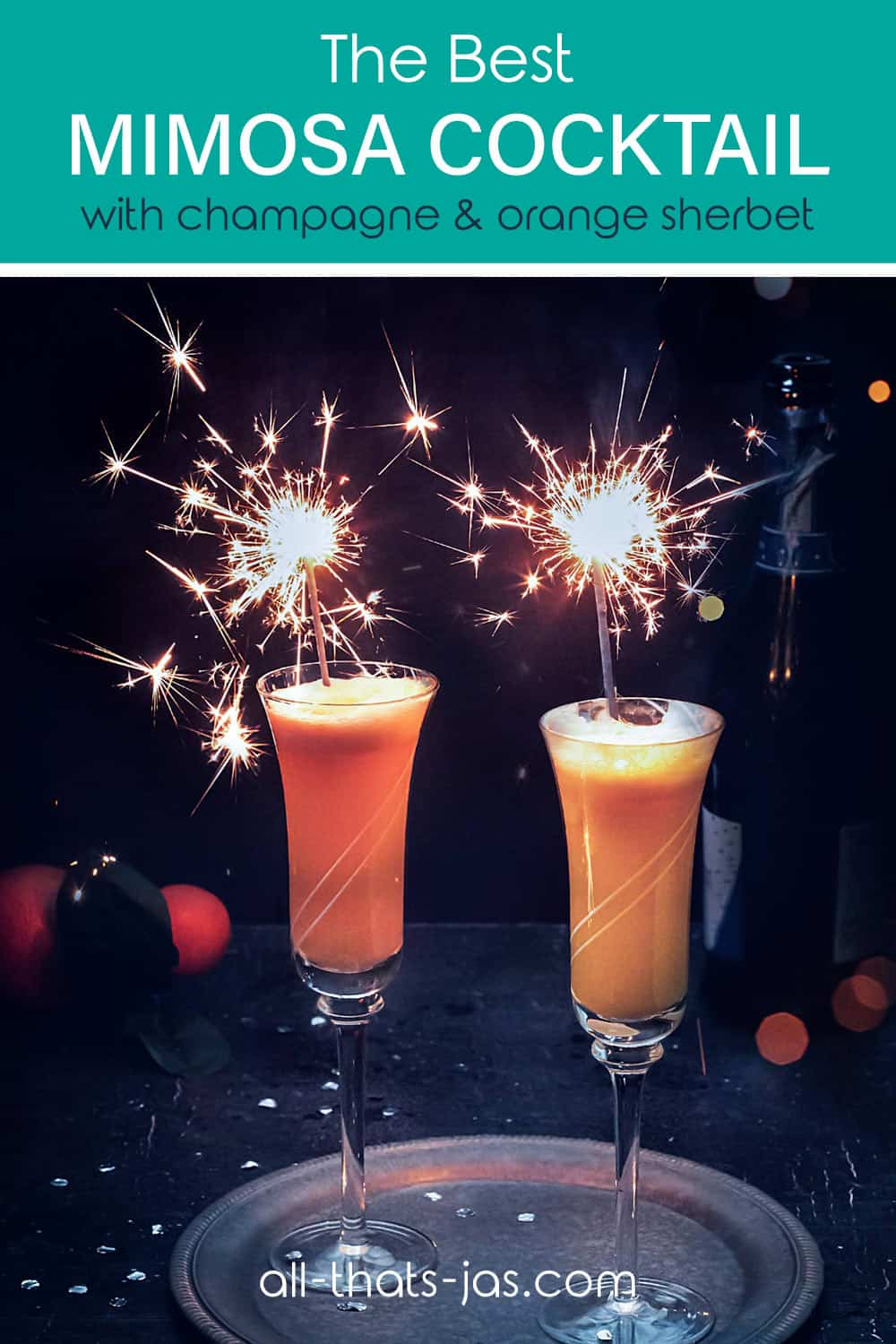 New Year's mimosa cocktail with sparklers and text overlay.