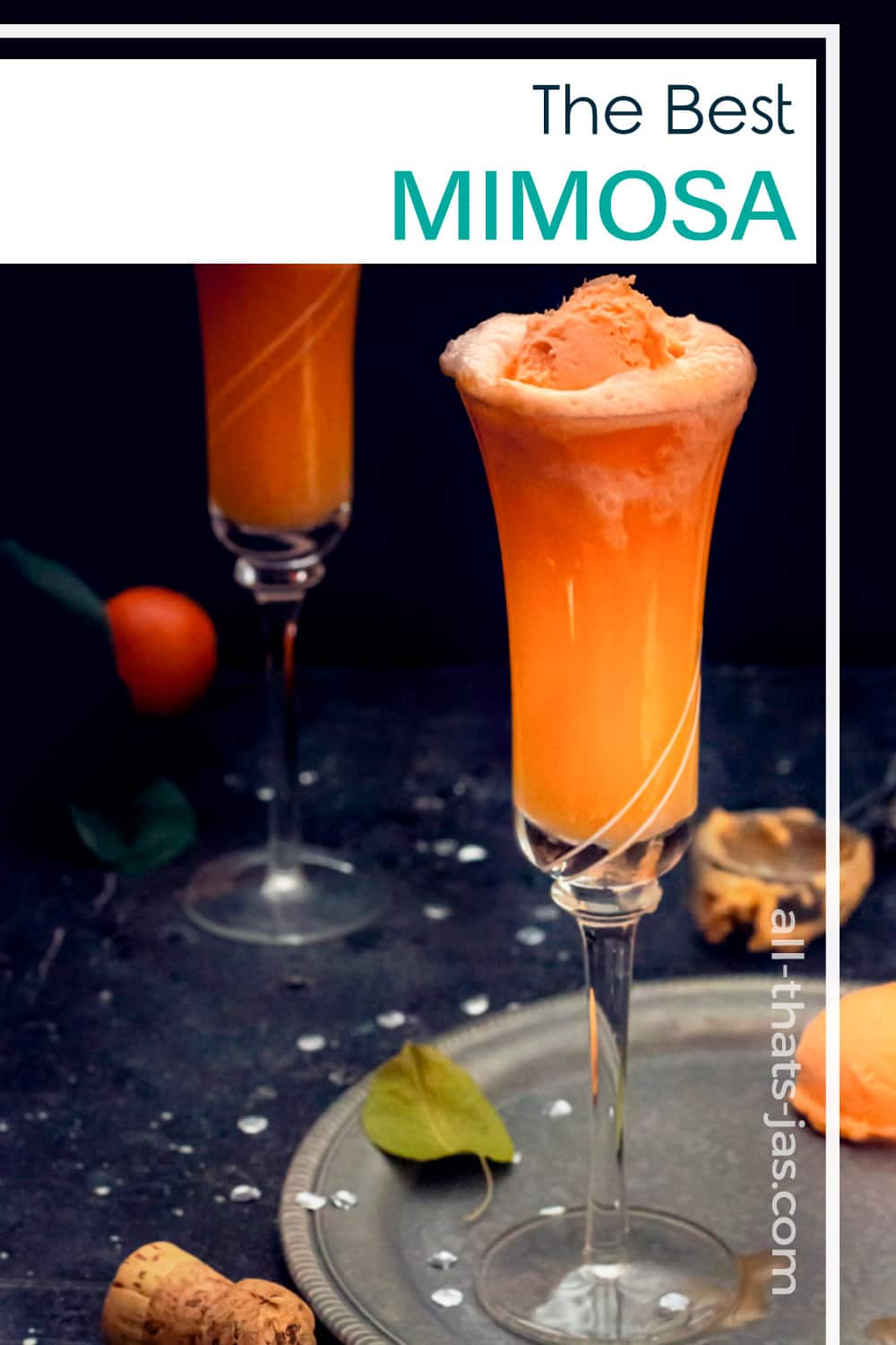 Champagne orange sherbet mimosa in a glass with text overlay.